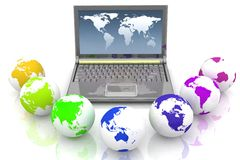 Laptop and globes of all colors of rainbow. Conception global computer network Stock Photo