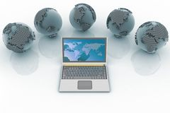 Laptop and globes. Conception global computer network Stock Photography