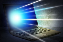 Laptop with glowing spot Royalty Free Stock Photo