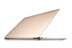 Laptop gold colors Royalty Free Stock Photos