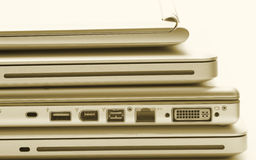Laptop gold. Laptops stacked with a gold filter royalty free stock photography