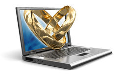 Laptop and Gold rings (clipping path included). Laptop and Gold rings. Image with clipping path Royalty Free Stock Images