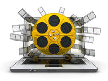 Laptop and gold spool Royalty Free Stock Images