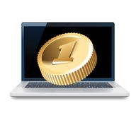 Laptop and golden coin Royalty Free Stock Images