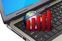 Laptop with graph and earth. Royalty Free Stock Photos