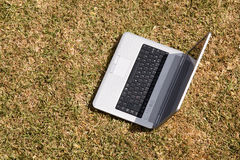 Laptop on the grass Stock Photos