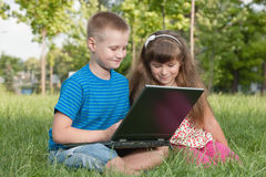 With a laptop on the grass Royalty Free Stock Photography