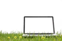 Laptop on grass Royalty Free Stock Images