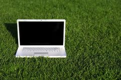 Laptop on grass Stock Photography