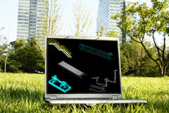 Laptop on Grass with 3D Model Stock Photo