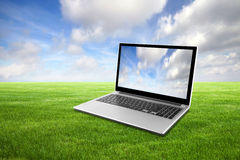 Laptop on green grass Stock Photo
