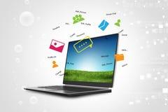 Laptop on green grass Royalty Free Stock Photos