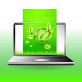 Laptop with green mail Environment concept Stock Photos