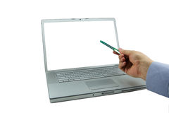Laptop with green pointing pen Royalty Free Stock Image