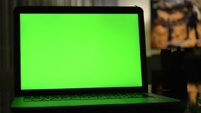 Laptop with green screen. Dark home office . stock video