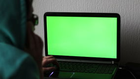 Laptop with a green screen stock video
