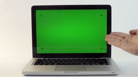 Laptop with a Green Screen. On a White Backdrop stock video