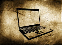 Laptop with grunge textured Royalty Free Stock Photo