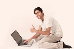 Laptop guy thumbs up Stock Photo