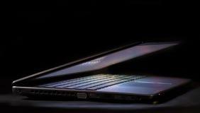 Laptop half open. In the dark Stock Images