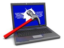 Laptop and hammer Royalty Free Stock Photos