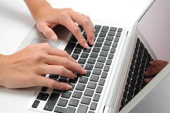 Laptop and hand. Desk with laptop and human hand Stock Photography