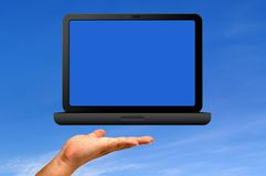 Laptop and hand Royalty Free Stock Images