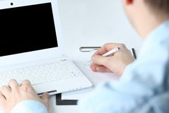 Laptop hand. Human hands working on laptop on office background Stock Image