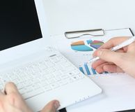 Laptop hand. Businessman analyzing investment charts at his workplace Royalty Free Stock Photo