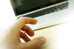 Laptop and Hand Royalty Free Stock Image