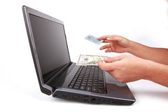 Laptop and Hand give Credit Card or money Royalty Free Stock Photos