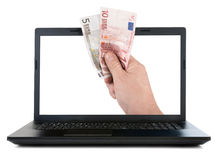 Laptop and hand giving Euro banknotes Royalty Free Stock Images