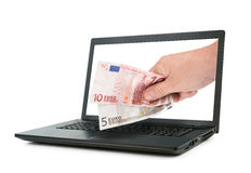 Laptop and hand giving Euro banknotes Royalty Free Stock Image