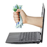 Laptop Hand Grabbing Money Euro Isolated. Male hand grabbing 100 Euro bills coming out from laptop isolated white Royalty Free Stock Photo
