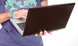 Laptop in hand Stock Image