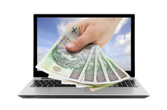 Laptop and hand with polish money Stock Images