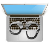 Laptop handcuffs Royalty Free Stock Photos