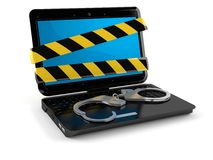 Laptop with handcuffs Royalty Free Stock Photography