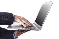 Laptop In Hands Stock Photo