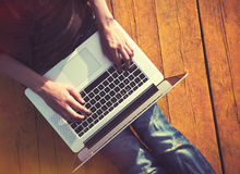 Laptop in hands typing Royalty Free Stock Photos