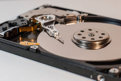 Laptop hard disk inside, detail preview. Laptop Harddisk inside with magnetic heads and data store surface royalty free stock image