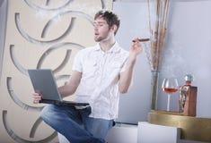 Laptop, havana and cognac Royalty Free Stock Photo