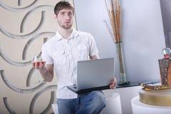 Laptop, havana and cognac Royalty Free Stock Image