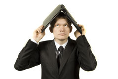Laptop on the head. The guy keeps his head in the laptop Royalty Free Stock Images