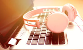 Laptop headphone with sunlight Stock Images