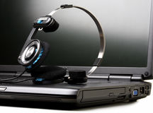 Laptop and headphones Stock Photography