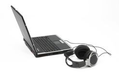 Laptop with headphones. A laptop with headphones on white background Stock Photo