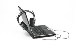 Laptop with headphones. A laptop with headphones on white background Stock Photography
