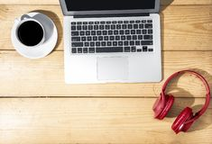 Laptop, Headphones And Cup Of Coffee On Wooden Table Stock Photo