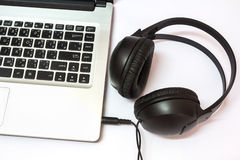 Laptop with headphones Royalty Free Stock Photography
